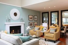 "Small Apartment Living Room: pretty, chic modern. Love the mix of warmer and cooler colors. White, turquoise / aqua / ""Tiffany blue"", light mustard yellow, beige. The use of the mirrors, lamps, cushions."