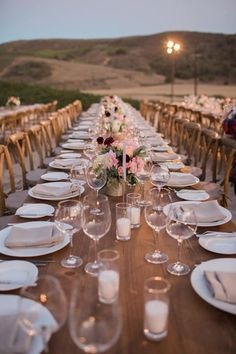 Beautiful, long wooden table should not be covered, flowers and simple white china are all you need ~ http://www.weddingchicks.com/2016/03/08/laid-back-luxury-winery-wedding/