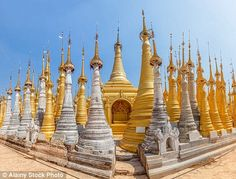 To attain merit Buddhists apply gold leaf to the statues to restore them from their decayi...