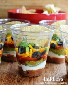 These 7 layer dip party cups are filled with the perfect 7 layer dip, in individual cups to make them the perfect appetizerfor your next party.