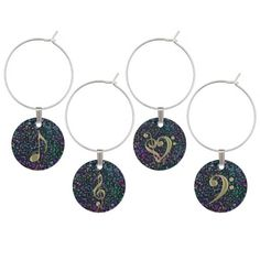 Gold on Music Notes Tapestry Wine Charms Collection. A background of glittery rainbow musical notes with gold musical symbols including a Music Clef Heart, a treble clef, bass clef and 8th note for your next wine party. These also make a lovely gift for your favorite musician or music lover.   #music  #wine