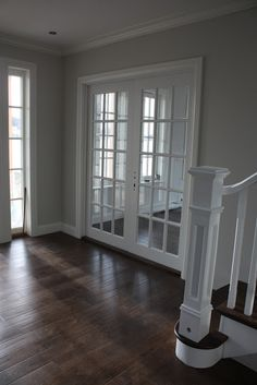 Grey walls, white trim, dark floors.