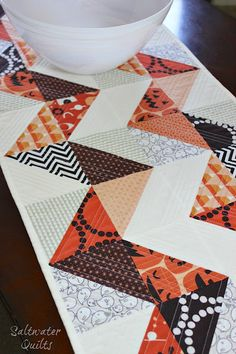 Saltwater Quilts: Reversible Halloween Table Runner. I love the half square triangles on this runner and that it is reversable.