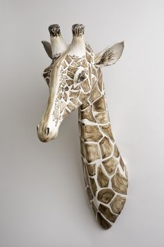 Giraffe by Katharine Morling Dimensions: 75 x 30 x 43 cm Materials: Earthstone, porcelain slip, porcelain and black stain Techniques: Hand building image by Stephen Brayne