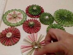 Christmas Paper Rosettes Tutorial. This is my version of how I make my handmade paper rosettes but you can also check out UKMARYANNE for her version aswell-tfw! The paper collection is from K&Company Yuletide collection here is a link to my haul vid on