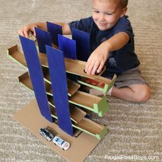 "Cardboard box ramps and car race for Hotwheels and Matchbox cars. Great tutorial post on how this was made. There is also a video to show it in action! by ""Frugal Fun for Boys""."