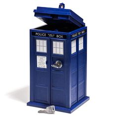 I'm debating which of my children is my favorite—for it is only the favorite that will get this for Christmas. --->ThinkGeek :: Doctor Who TARDIS Mini Safe