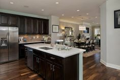 love the dark cabinets with the light granite, backsplash and walls