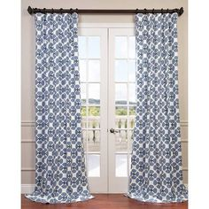 Update your bedroom with this blue printed curtain panel. The geometric floral pattern and neutral colors are versatile and complement a variety of decors. Surround this curtain with green, blue and w