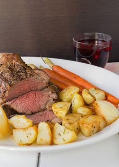 Roast beef dinner (Sunday roast). Roast beef, carrots, potatoes and Yorkshire pudding. A British tradition.
