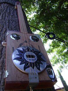The Black Sun Resonator Guitar Rack, Guitar Pins, Cigar Box Guitar Plans, Cigar Box Projects, Banjo, Axe, Wood Working, Architecture, Black