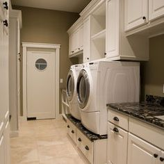 small laundry room - storage in the pedestals for washer/dryer