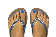 Brown MADiL sandals with bright blue bands and happy face charm. www.mymadil.com