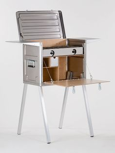 """The Field Kitchen from Kanz Outdoors is built to hold a stove and all your  cookware. Add their certified bear resistant Field Pantry and a portable  fridge for a complete outdoor kitchen system. Both the Pantry and Kitchen  are made of deep drawn marine-quality aluminum panels for light weight and  high impact strength. Kanz Outdoors also offers a Field Power Desk but here  at The Man's Man we get out in the outdoors to get away from the """"desk""""."""