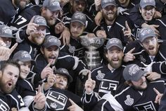 Kings players gather around the Stanley Cup for a group photo after defeating the New Jersey Devils, 6-1, in Game 6 on Monday night at Staples Center.