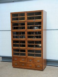 Haberdashery Cabinet -  mahogony fronts, period nickel plated brass fittings, oak drawers dove-tailed front and back that slide out from behind up and over glass doors.
