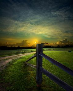 """""""In life we pass many fence posts, never knowing where the road truly leads we follow the line until one day it ends. And at the end a new beginning awaits.""""   ~Phil Koch"""