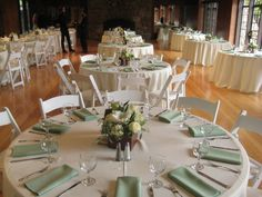 Celadon green napkins with ivory linens are a subtle incarnation of a celedon green wedding reception theme, seen here at the Brazilian Room.