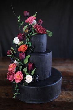 Beautifully Baroque  With its exaggerated elements and rich contrasts (matte black and Marsala-hued blooms), this decadent design captures the drama of the baroque era.  Venue: Rixey Manor in Virginia Planning And Design: A Daily Something Florals: Loda Floral Design Cake: Dulce Custom Cakes
