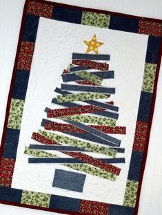 Looking for your next project? Youre going to love Blue Jean Christmas Tree Wall Hanging by designer Inventive Denim. - via Craftsy Christmas Tree Quilt, Christmas Wall Hangings, Christmas Runner, Christmas Sewing, Christmas Fabric, Noel Christmas, Christmas Ornaments, Modern Christmas, Green Christmas