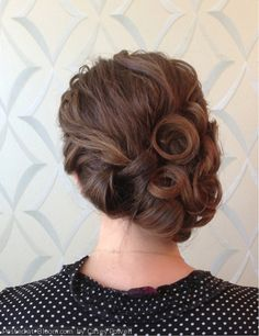 A pinned updo perfect for any occasion. By Casey Powell.