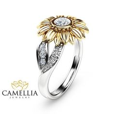 This is a natural diamond sunflower engagement ring from Camellia Jewelry. This unique design ring features a solid 14K two tone gold band with