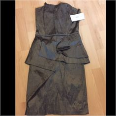 IXIA Peplum Style Gray Dress Brand New with Tags. Size medium, flattering for, top has boning for a more sliming silhouette Ixia Dresses Strapless