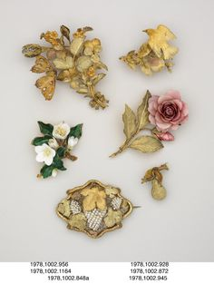 Hair or corsage ornament; bloomed and chased three-colour gold; set with diamonds; form: large spray of mixed flowers; diamond-set butterfly mounted on trembler spring. Pansies, left: lower petal green with three gold bands, side petal green with one gold band. right: lower petal green with gold tip. Butterfly wings: 'eyes' with diamond surrounded by green on gold. Underside of wings chased and engraved with legs separate. Body green.