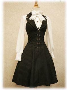 Corporate Goth dress; subtle quirk.