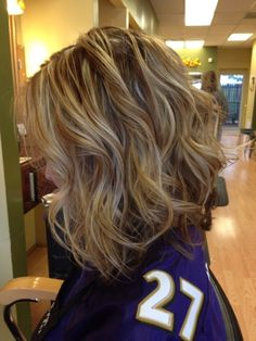 Inverted long bob, brown lowlights and blonde highlights. Styled with curling wand. This would be cute on you. by bridgette.jons