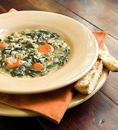 In a large stockpot, heat olive oil over medium-high heat. Add onion, celery, carrots, and garlic and cook for 5 minutes, or until onion is translucent. Add spinach and cook for approximately 4 minutes to wilt. Add lentils, chicken broth, lemon zest, lemon juice, salt, and pepper. Increase heat to high. Bring soup to a boil. Serve immediately.