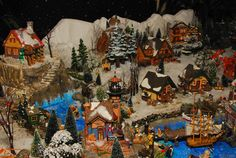 Unique hunting/fishing themed Department 56 village display, featuring faux rocks and mountains created from foam with Hot Wire Foam Factory tools. Christmas Village Display, Christmas Villages, Foam Factory, Hawthorne Village, Faux Rock, Lemax Village, Halloween Village, Fishing Villages, Beautiful Christmas