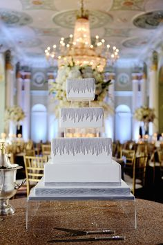 A squared cake with modern, metallic silver details. #WeddingCake Photography: Milanés Photography. Read More: http://www.insideweddings.com/weddings/white-silver-gold-wedding-at-the-biltmore-ballrooms-in-atlanta/680/
