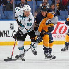 San Jose Sharks forward Barclay Goodrow battles Chris Stewart of the Buffalo Sabres for the puck (Nov. 18, 2014).