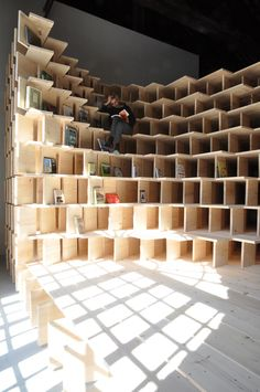 Architects Aljoša Dekleva and Tina Gregorič have built a wooden library inside the Slovenian Pavilion at the Venice Architecture Biennale that examines the role of the 'home' today. Venice Biennale, Co Working, Library Design, Exhibition Space, Office Interiors, Retail Design, Store Design, Interior Design Living Room, Interior Architecture