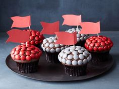 Tampa Bay Buccaneers : Red and pewter gray are this team's colors; luckily candy-coated chocolates come in nearly every shade. Use them to decorate chocolate-frosted cupcakes and crown each with a paper flag.