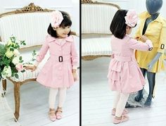 How absolutely adorable is this! Pink pea coat with ruffles on the backside.
