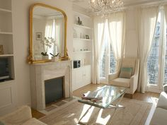 Serene and flooded with light/shabby chic white living room with fireplace/Nordic French apartment in Paris we rented/Hello Lovely Studio Paris Apartment Interiors, French Apartment, Apartment Chic, Apartment Interior Design, Apartment Layout, Apartment Living, Living Rooms, Parisian Decor, French Interior Design