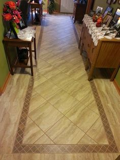 A custom Luxury Vinyl Tile job installed in the basement adds durability, warmth and style! These vinyl tiles are thicker and warmer than ceramic tile, but offer the same easy maintenance and beautiful designs!