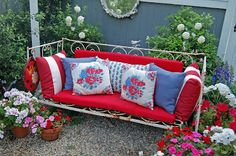 You are Invited to My Garden Party | She found an old iron French Country daybed and found red cushions from Walmart and end of the season end cushions from Pottery barn. | This web page is full of color and beautiful inspiration! Lovely gardens!