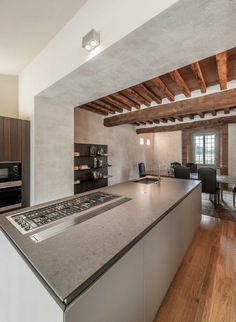 Kitchen island features a built-in stove
