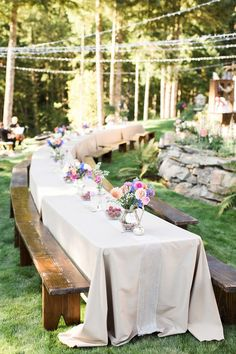 long tables (but not wooden) with natural linens and tons of candles