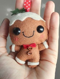Felt Gingerbread Man Ornament: Doesn't have any directions, but how hard could it be? It's so cute!