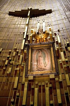 Altar Basilica of Lady Guadalupe - Mexico City, Mexico. The Basilica contains the imprint of the Blessed Virgin Mary that miraculously appeared on the tilma of an Aztec peasant Juan Diego in 1531. The tilma has maintained its structural integrity over nearly 500 years, and survived a bomb explosion in 1921 intended for its destruction. The bomb damaged the altar, but left the icon unharmed.