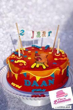 Dikkie Dik taart met vlaggetjes en vlaggenlijn. De taart is met airbrush gespoten.