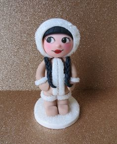 Tutorial: How to make an Eskimo girl cake topper | CakeJournal.com