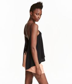 Black. Top in airy, woven fabric with a V-neck. Narrow shoulder straps, ties at back, and completely open back. Half-lined at front.