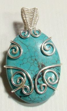 Nice tutorial for pin beading on this silver and turquoise wire jewelry pendant any mommy-to-be would love to receive as a gift.