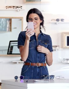 Queen Kendall — September 25, 2015- Kendall trying on glasses at...
