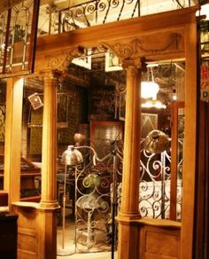 Victorian room divider and slag glass lamp separating the kitchen